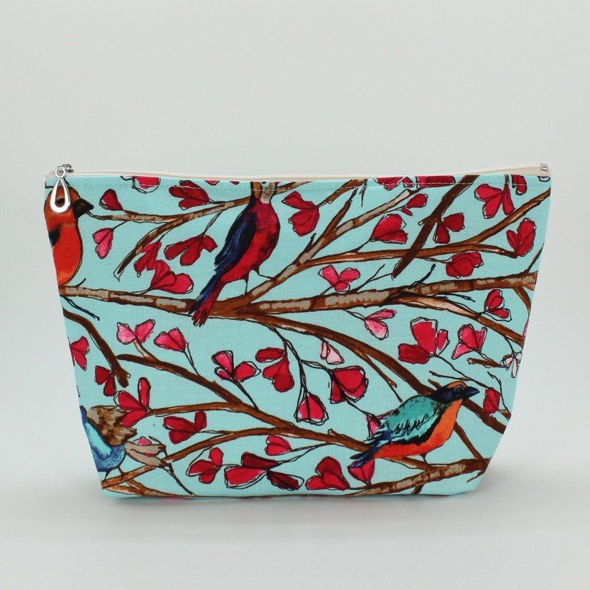 Large cosmetic bag bird print made of cotton in the U.S.A. with cheerful print and cotton and waterproof plastic.
