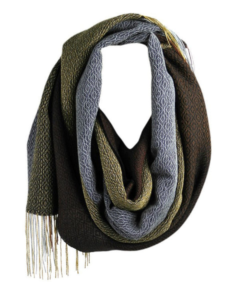 Liviano scarf cappuccino is made mostly of natural hypoallergenic and sustainable alpaca artisanally loomed into this lustrous garment.