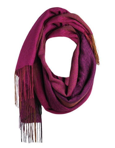 Liviano scarf magenta is made mostly of natural hypoallergenic and sustainable alpaca artisanally loomed into this lustrous garment.