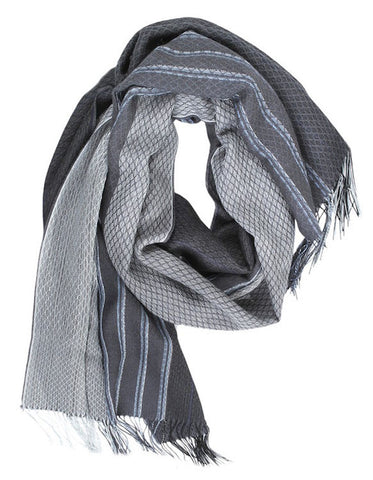 Liviano scarf titanium is made mostly of natural hypoallergenic and sustainable alpaca artisanally loomed into this lustrous garment.