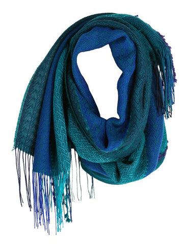Liviano scarf turquoise is made mostly of natural hypoallergenic and sustainable alpaca artisanally loomed into this lustrous garment.