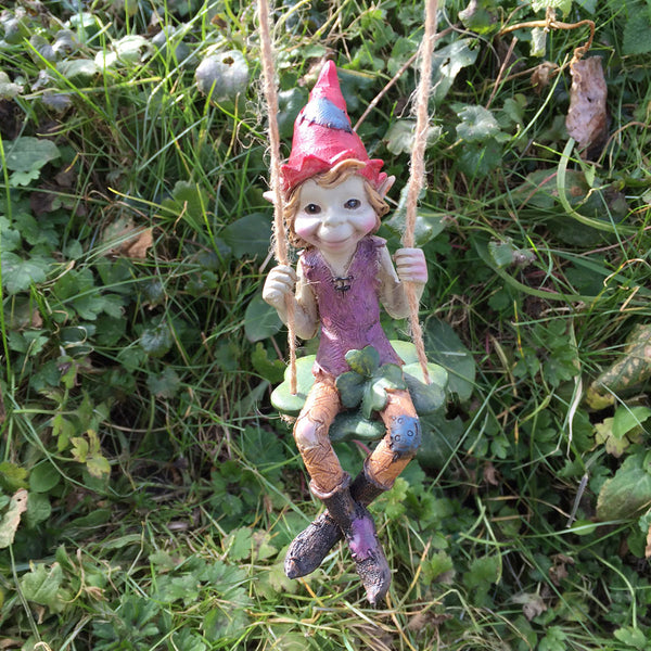 Pixie Hanging on a Clover Swing Sculpture by Tony Fisher