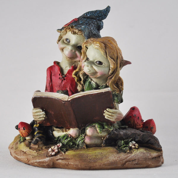Pixie Couple Reading a Book by Tony Fisher