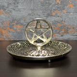 Silver coloured metal incense plate featuring a pentagram symbol