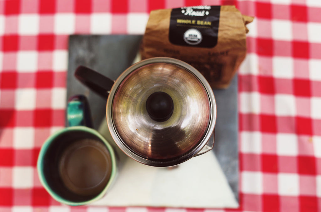 French press boiling water coffee while camping hack