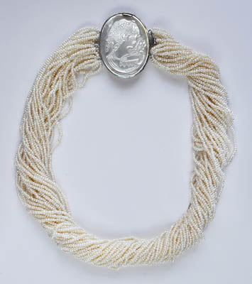 FWP 170 A twisted necklace 38cm long w/31 rows of small white pearl 1.3mm beads.