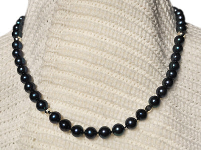 FWP 182 Single black freshwater pearl 7.8mm necklace 41cm long with silver beads.