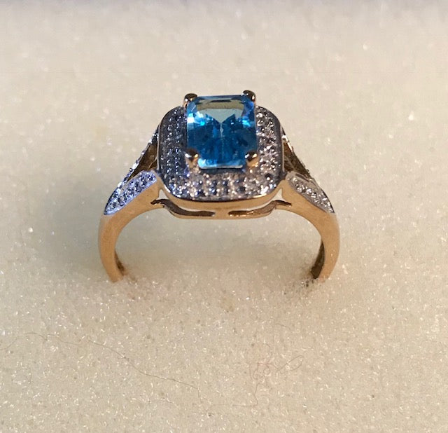 RIN 077 Gold 9k. w/blue topaz and diamonds size N.