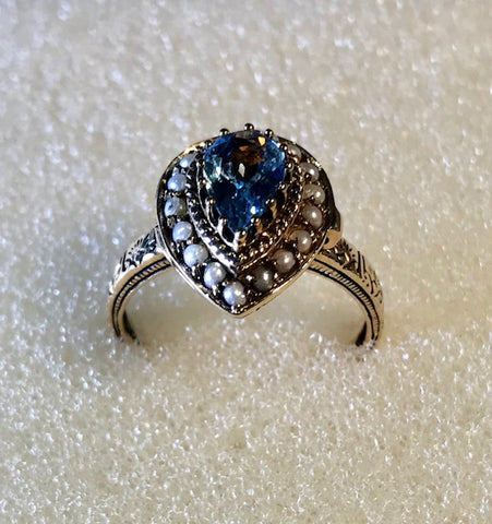 RIN 080 Gold 9k. ring w/blue topaz, pearls and diamonds size O.