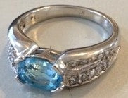 RIN 220 White gold 9k. ring w/topaz and diamonds size N.