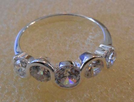 RIN 224 Silver ring with 5 cubic zirconia size P.