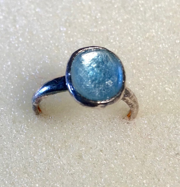 RIN 226 Blue Topaz on silver ring size N.