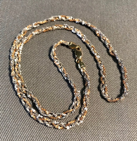 "SP 104 White/rose braided gold chain-18k./18"" long."