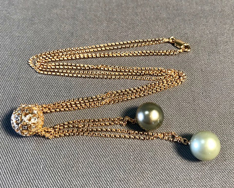 SP 107 Gold chain 14k ending in South Sea Pearl drops.