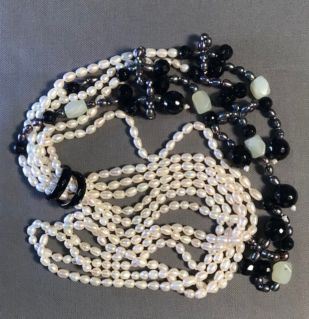 SP 129 Long Necklace 40cm of 3 strands of white freshwater pearls.
