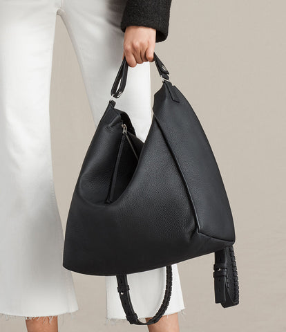 """ead8958eed From the site  """"The Kita Backpack can be styled on the back with the  whipstitch-trimmed shoulder straps"""