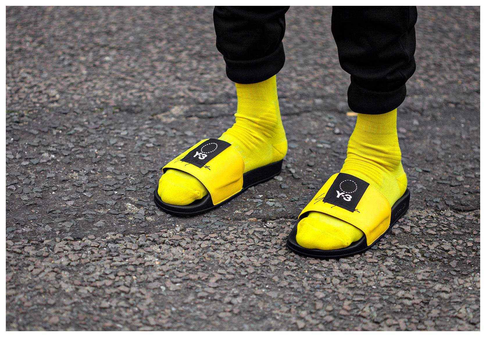 Detailed Shot of model wearing Yellow Y-3 Adilette slides and Yellow Y-3 socks