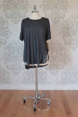 Nanavatee short sleeve top with long back tail and side splits.Charcoal grey