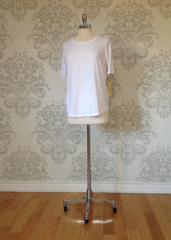 Nanavatee short sleeve white cotton slub top with side splits.