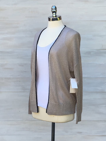 Lightweight open cardigan. Beige with black trim. Press