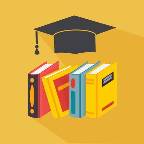 Image of books and graduation cap