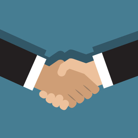 Two hand handshake on a blue background.