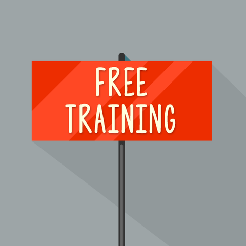 Free training sign on a grey background.