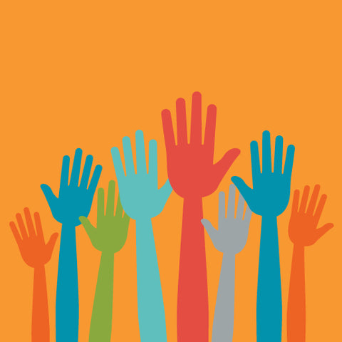Different colored raised hands on a orange background.