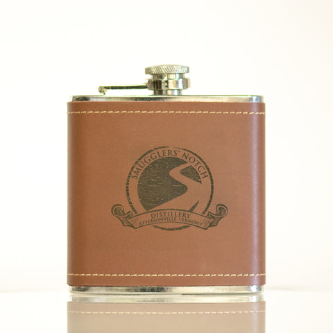 6 oz stainless steel flask with brown leather wrapping, engraved with SND's vintage logo | Smugglers' Notch Distillery Online Store