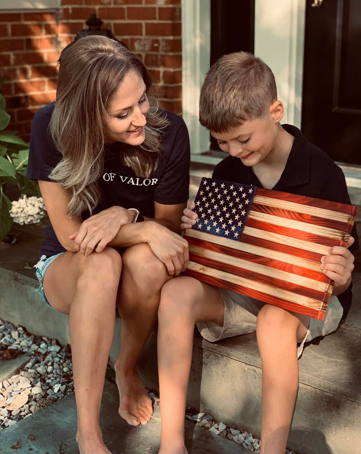 Flags of Valor child holding wooden American flag