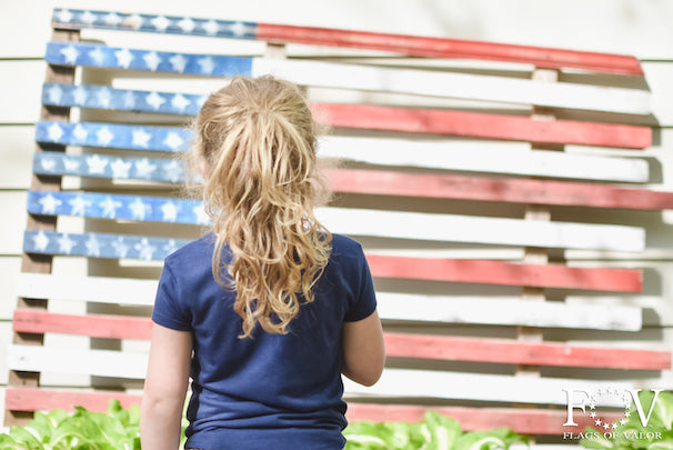 Child says pledge to wooden American Flag, Flags of Valor