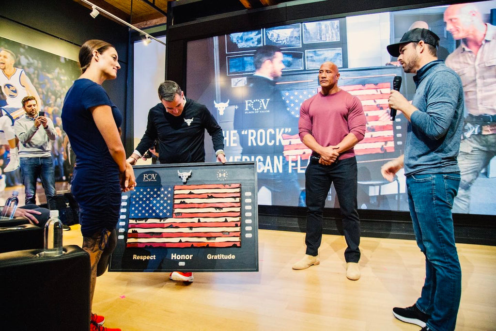 Flags of Valor Brian Steorts with Kevin Plank Dwayne Johnson and Ellie Marks