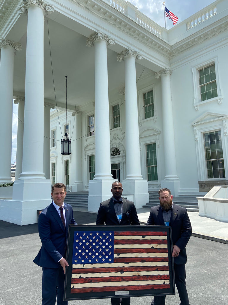 Personalized wooden American Flag for White House Press Secretary Kayleigh McEnany in front of White House Mansion