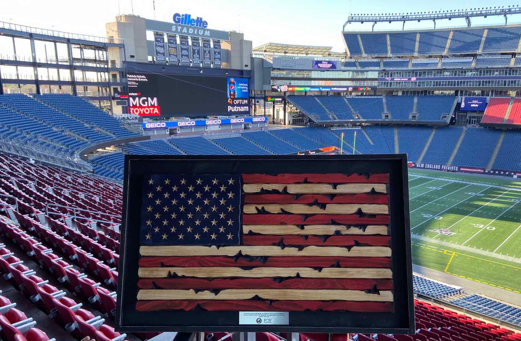 Flags of Valor wood flag in Gillete Stadium prior to presentation to Robert Kraft