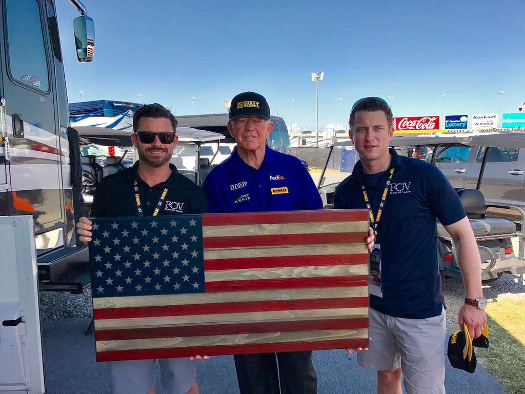Brian Steorts and Joe Shamess giving wooden American flag to legendary Joe Gibbs