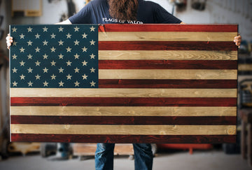 First Responder (XL) Wooden American Flag being held by a Combat Veteran
