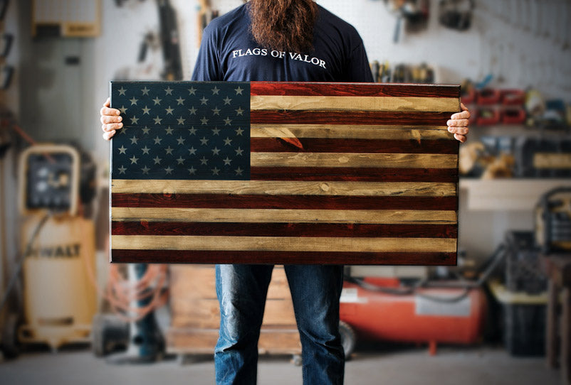 Welcome Home (M) Wooden American Flag being held by a Combat Veteran