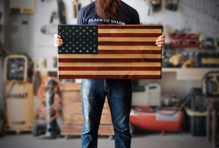Phantom Fury (S) Wooden American Flag being held by a Combat Veteran