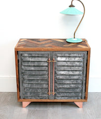 vintage industrial sideboard combining polished metal with reclaimed parquet wood to create a tactile piece of furniture, home bar, mini bar console table or bedside table