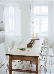 gorgeous old wooden bakers table used as a dining table in crisp white modern kitchen diner