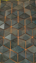 amazing 3D cubed wall cladding in grey wood and copper by John Houshmand