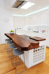 Gorgeous wooden kitchen island with a Waney edge finish almost butchers block like