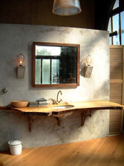 single slab of wood turned into bathroom sink with a Waney edge finish