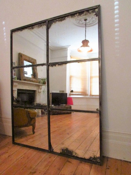 Hand crafted Antique Mercury glass Mirror set in hand polished steel framework