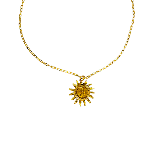 A Sunray Pendant Necklace in Gold and Citrine.