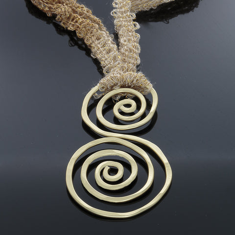 Gold Double Spiral abstract necklace on adjustable yarn/ribbon - Finesse Jewelry