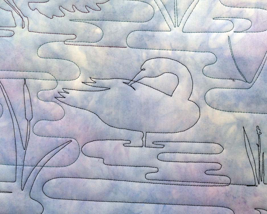 preening duck quilted in pond background