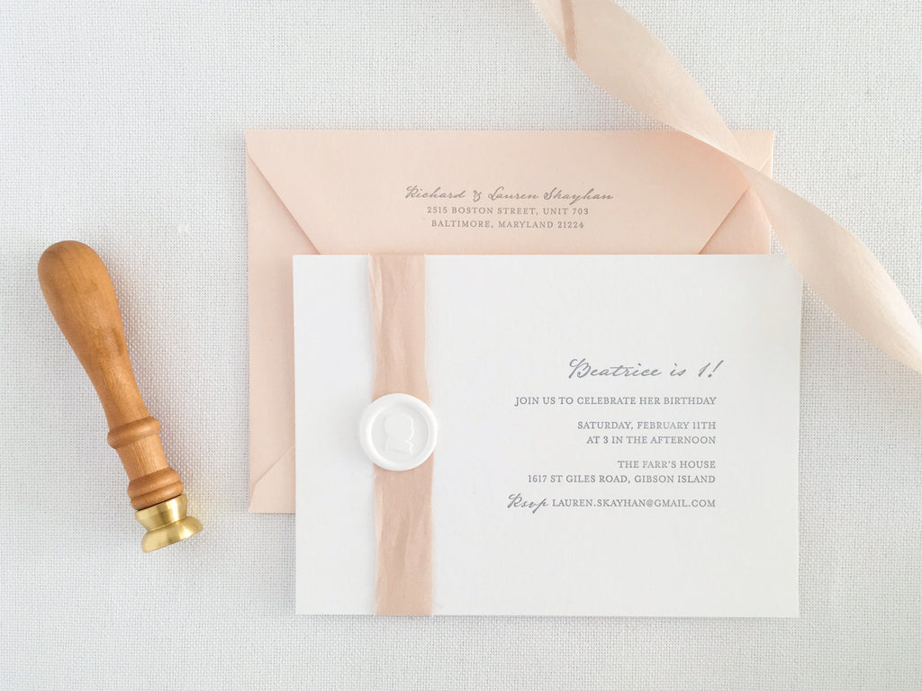 Letterpress First Birthday Party Invitations featuring silhouette wax seal and silk ribbon