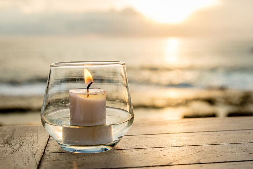 candle on seaside table