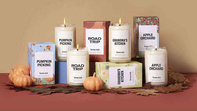 assortment homesick candles in autumn layout